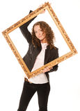 Beautiful woman standing and holding gold frame Royalty Free Stock Photography