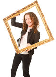 Beautiful woman standing and holding gold frame Royalty Free Stock Photo