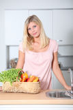 Beautiful woman standing in kitchen Stock Image
