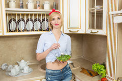 Beautiful woman standing in kitchen royalty free stock photography