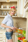 Beautiful woman standing in kitchen royalty free stock photos