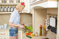 Beautiful woman standing in kitchen stock photo