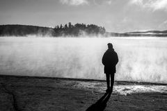 Beautiful woman standing lake of two rivers algonquin national park Canada look sunrise mist in the fog clouded swamp Stock Images