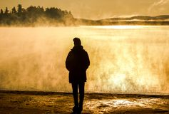 Beautiful woman standing lake of two rivers algonquin national park Canada look sunrise mist in the fog clouded swamp. Beautiful woman standing at lake of two stock images