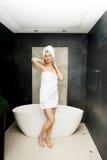 Beautiful woman standing near bathtub. Stock Photos