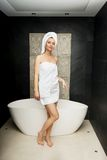 Beautiful woman standing near bathtub. Stock Photography
