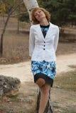 Beautiful woman standing near birch Royalty Free Stock Image