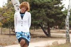 Beautiful woman standing near birch Stock Photos