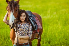 Beautiful woman standing near a horse Stock Images