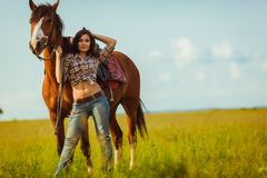 Beautiful woman standing near a horse Stock Photos