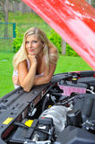 Beautiful woman standing near red car Royalty Free Stock Images