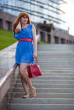 Beautiful Woman Standing On The Stairs Royalty Free Stock Images