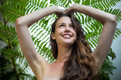 Beautiful woman standing outdoors in garden Royalty Free Stock Photography