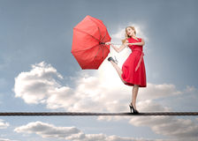 Beautiful woman standing on rope stock photos