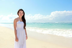 Beautiful woman standing on sand and looking at the camera Stock Image