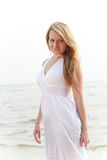 Beautiful woman standing on seashore Stock Photo