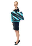 Beautiful woman standing with shopping bag Royalty Free Stock Photos