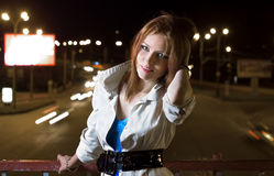 Beautiful woman standing on street at night Royalty Free Stock Images