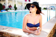 Beautiful woman standing in swimming pool Royalty Free Stock Photos
