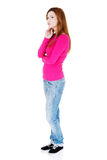 Beautiful woman standing and thinking. Royalty Free Stock Photo
