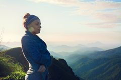 Woman on top of a mountain. Beautiful woman is standing on top of a mountain Stock Photos