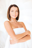Beautiful woman standing in towel Royalty Free Stock Image