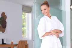 Beautiful woman standing in white bathrobe Royalty Free Stock Photos