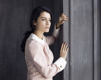 Beautiful woman standing by a window Royalty Free Stock Photography