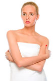 Beautiful woman standing wrapped in white towel Royalty Free Stock Images