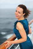 Beautiful woman stands on board of large ship Stock Images