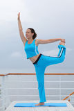 Beautiful woman stands and does exercise Stock Image