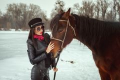 Beautiful woman stands near a horse royalty free stock photos