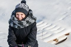 Beautiful woman stands in white snow clearing. Young, beautiful woman stands in white snow clearing Stock Photo