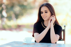 Beautiful Woman with Statement Necklace Having a Cup of Coffee Royalty Free Stock Photos