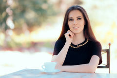 Beautiful Woman with Statement Necklace Having a Cup of Coffee Stock Image
