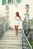 Beautiful woman stepping down stair Stock Photo