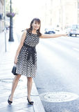 Beautiful woman stopping car in the city Royalty Free Stock Images