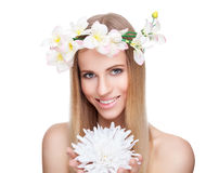 Beautiful woman with straight hair and flowers Royalty Free Stock Photography