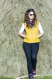 Beautiful woman in straw field with bales. portrait Royalty Free Stock Photos