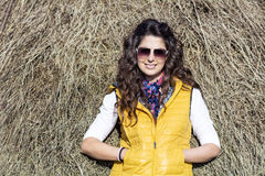 Beautiful woman in straw field with bales. portrait Royalty Free Stock Photography
