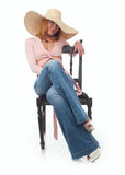 Beautiful woman in a straw hat Stock Photography