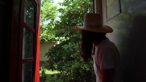Beautiful woman in straw hat enjoying the trip. Famous Sri-Lanka railways stock footage