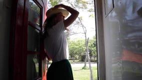 Beautiful woman in straw hat enjoying the trip. Famous Sri-Lanka railways stock video footage