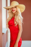 Beautiful woman in straw hat with large brim Royalty Free Stock Images