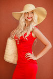 Beautiful woman in straw hat with large brim Royalty Free Stock Image