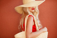 Beautiful woman in straw hat with large brim Stock Photo