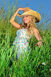 Beautiful woman in straw hat on the nature. Royalty Free Stock Photos