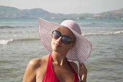 Beautiful woman with straw hat posing near beach Stock Images