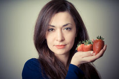 Beautiful woman with strawberries Stock Image