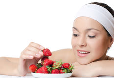 The beautiful woman with a strawberry Royalty Free Stock Photography